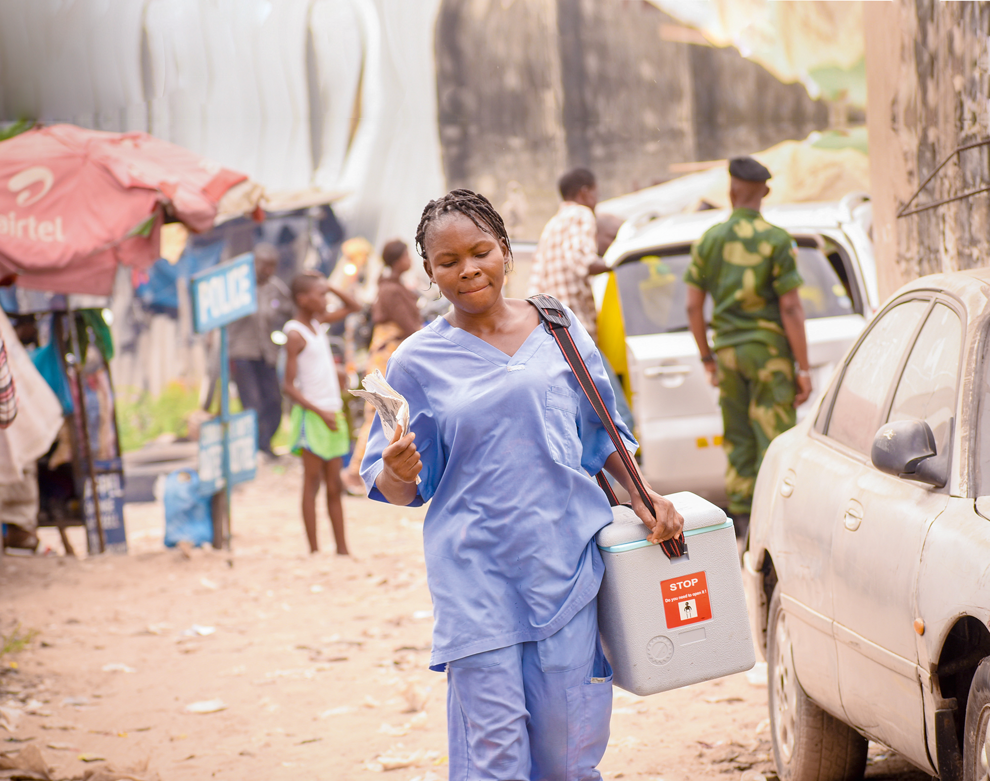 a health worker transports the day's vaccines from the health zone's central bureau to the health facility in Kinshasa.