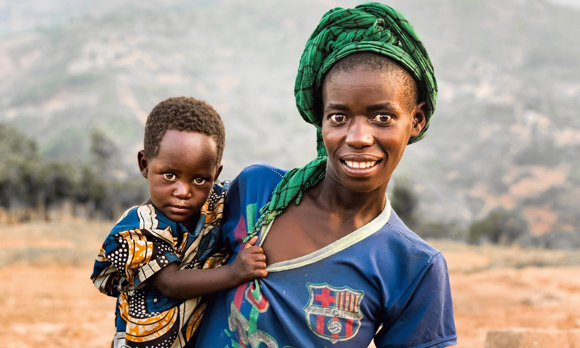 Rwandan mother carrying her child